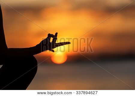 Close Up Silhouette Hands. Woman Do Yoga Outdoor. Woman Exercising Vital And Meditation For Fitness