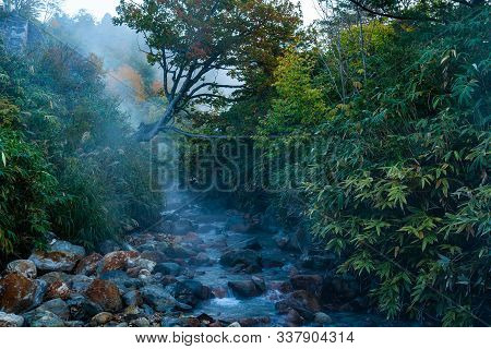 Morning View Of The Creek In Tamagawa Hot Spring With Stream Flow Over The Area In Autumn Season . T