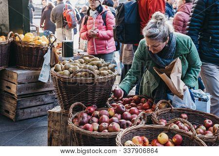 London, Uk - November 29, 2019: Woman Buying Fresh Apples From Teds Veg Stall In Borough Market, One