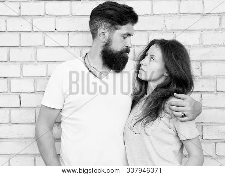 Moments Of Intimacy. Couple In Love. Family Couple Hugging On Brick Wall. Loving Couple Of Bearded M