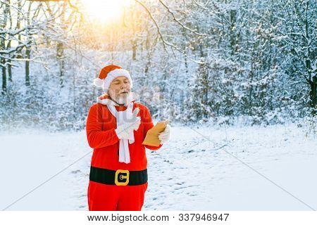 Santa Reading Christmas Letter To Santa Claus. Santa Reading Letter To Santa Claus On Snow Nature Fo