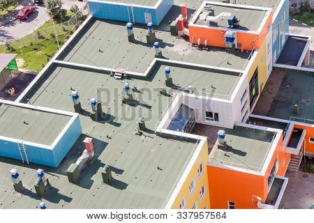 Top View Flat Roof With Air Conditioners And Hydro Insulation Membranes On Top Of A Modern Apartment