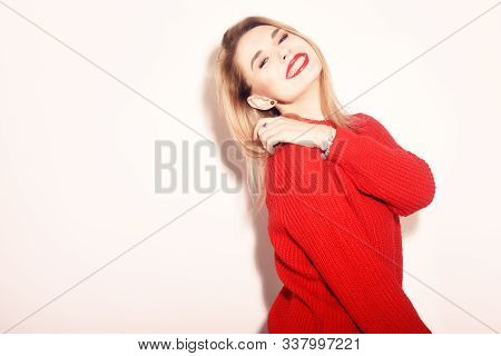 Happy Smiling Girl In Knitted Red Sweater Having Fun . Cute Blond Woman Winter Or Autumn, Spring War