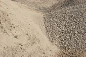 Sand and gravel piles. Raw materials used in the building construction industry. poster