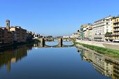Arno River with Ponte Santa Trinita from Ponte Vecchio. Florence, Italy. The oldest elliptic arch bridge in the world. poster