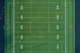 Aerial view of a football field at a suburban high school.