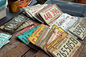 St. Charles, Illinois, USA. Sept. 1, 2019: Old license plates from Illinois found at a flea market.