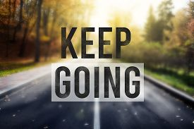 Quote Keep Going Over Road In Autumn Forest. Motivation Concept
