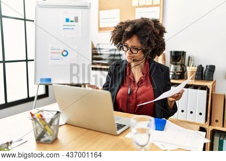 Young african american woman call center agent having video call at office