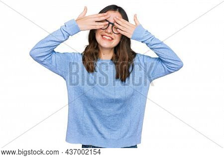 Young beautiful woman wearing casual clothes and glasses covering eyes with hands smiling cheerful and funny. blind concept.