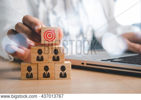 Business Woman Hand Holding Virtual Target Board And People Icon On Wooden Cube With Copy Space, Tar