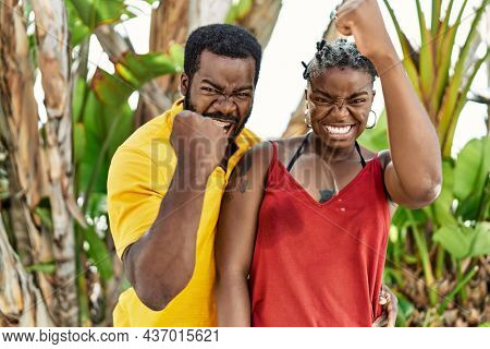 Young african american couple wearing casual clothes standing at the city annoyed and frustrated shouting with anger, yelling crazy with anger and hand raised