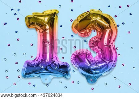 Rainbow Foil Balloon Number, Digit Thirteen On A Blue Background With Sequins. Birthday Greeting Car