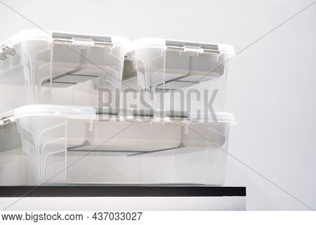 Plastic Containers On A Shelf On A Rack For Organizing Home Space, Order And Interior, Sale Of House