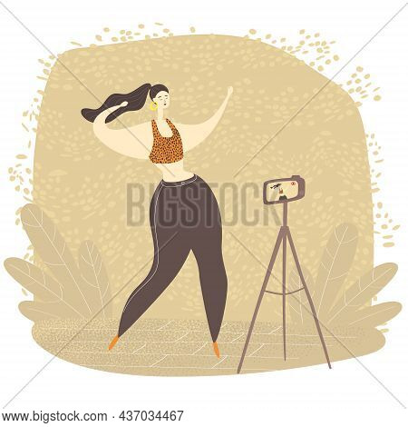 Female Video Blogger Is Dancing On Camera. Young Woman Is Live Streaming With Smart Phone. Dance Cha