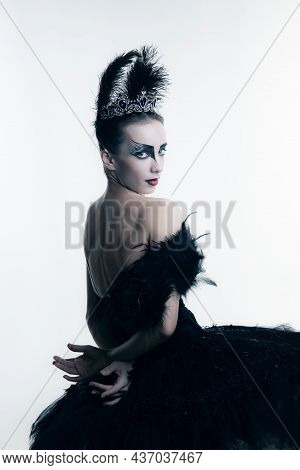 Studio Shot Of Young Ballerina Wearing Black Tutu, Stage Dress And Bright Make-up Posing Isolated On