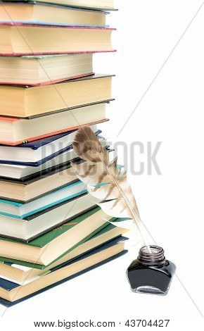 School Supplies. Quill In The Inkwell And A Stack Of Books On White Background.