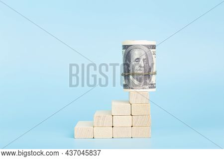 Dollars On The On Economic Growth On A Blue Background. International Currency And Money Of The Usa.