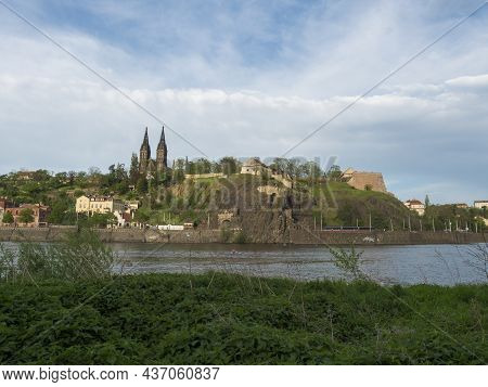 Vltava River Bank With View Of Historical Fort Vysehrad With Basilica Of St. Peter And Paul, Gothic