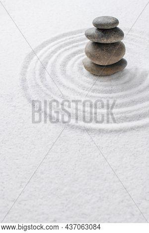 Stacked zen stones sand background art of balance concept