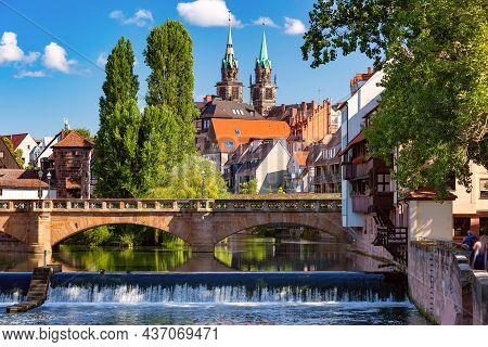 Sunny Church And Bridge Over Pegnitz River In The Old Town Of Nurnberg, Eastern Bavaria, Germany
