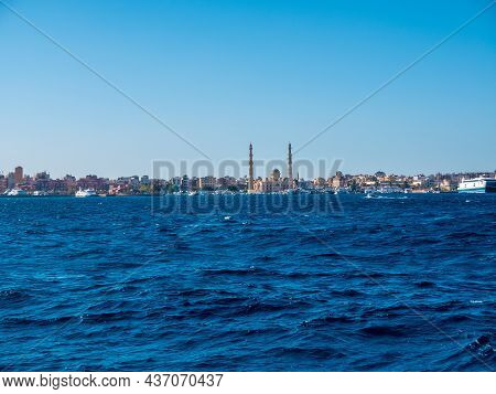 Wonderful View Of The Mosque With Two Minarets On The Seashore Against The Backdrop Of Sea Waves.