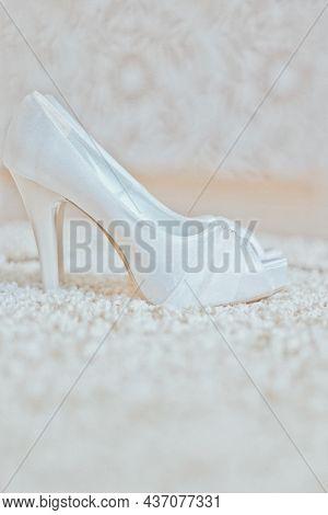 White bridal high heels, wedding photography