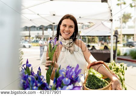 Woman doing flower shopping at a local market