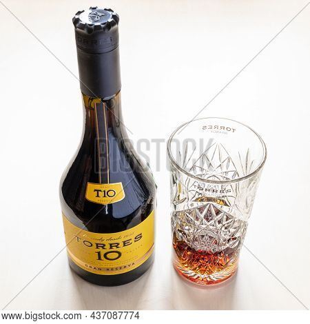 Moscow, Russia - October 16, 2021: Torres Gran Reserva 10 Spanish Brandy And And Crystal Tumbler. To
