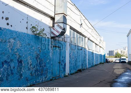 Shabby Painted Walls Of Warehouse In Summer Morning
