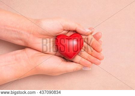 Health Care Concept With Heart In Hands. Heart As A Symbol Of Caring And Care