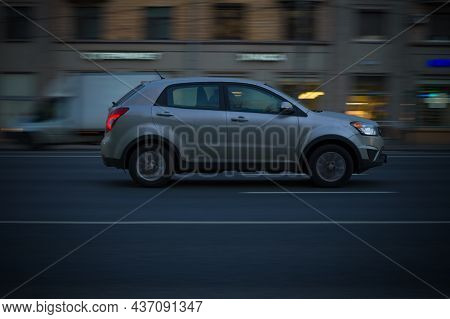 Moscow, Russia - October 2021: Ssangyong Actyon In Motion On City Street At Night. Racing At High Sp
