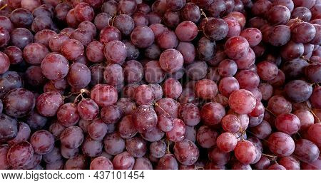 Grapes - Grapes In Baskets In Bulk. Close-up Detail Of Grapes