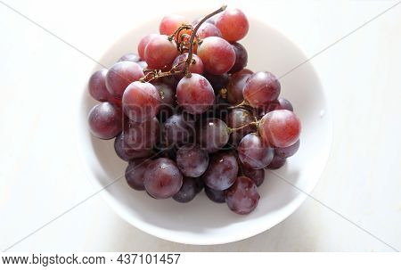 Grapes - Grapes In A Bowl On A White Background. Ripe Grapes Ready To Eat