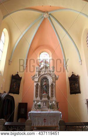 BOSILJEVO, CROATIA - JULY 15, 2012: Immaculate Heart of Mary, altar in the Church of St. Maurus the Abbot in Bosiljevo, Croatia