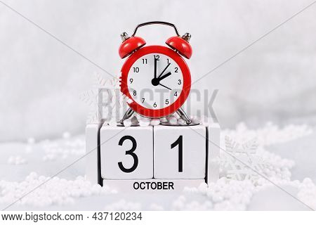 Time Change For Daylight Saving Winter Time In Europe On October 31st Concept With Red Alarm Clock A
