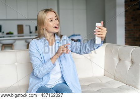 Joyful And Friendly Woman Making Video Call, Looking At Webcam At Her Smartphone And Using Online Ap