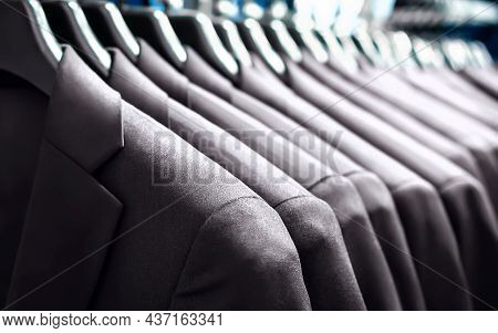 Suit Jackets In Hanger In Men Fashion And Apparel Store. Row Of Many Clothes In Rack Or Wardrobe. Ne