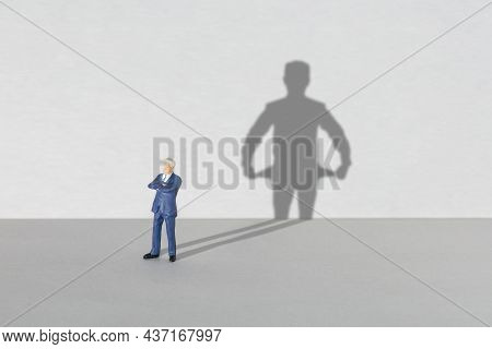 Poor Businessman. Shadow Of A Businessman With Empty Pockets Inside Out. Crisis Or Bankruptcy Concep