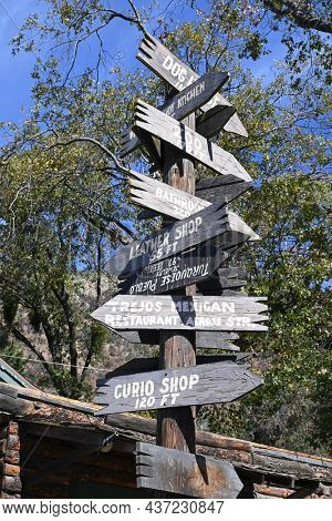 OAK GLEN, CALIFORNIA - 10 OCT 2021: Direction sign at Oak Tree Mountain established 50 years ago as a small apple shed has grown to be a 14- acre family fun park.