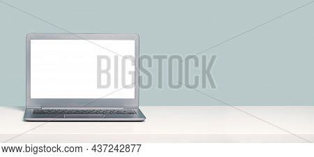 Front View Of The Laptop With Mockup Screen On The Desk