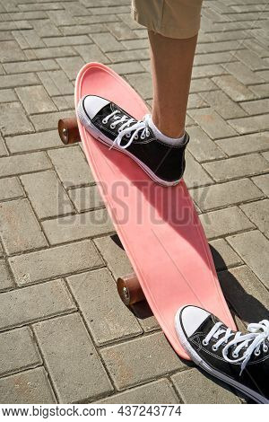Girl Stand On Skateboard. Town Landscape. Black Sneakers. New Normal Travel. Eco Trip. Local City Tr