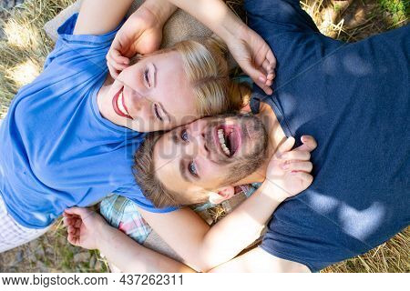 Young Lovers Hugging And Embracing. Couple In Love Tenderness And Affection. Top View.