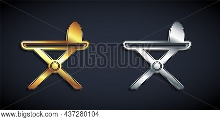 Gold And Silver Electric Iron And Ironing Board Icon Isolated On Black Background. Steam Iron. Long