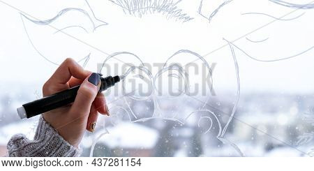 Female Hand Painting Christmas Deer Painted On Window Glass. Christmas Winter Decor On The Window Gl