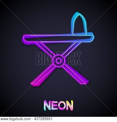 Glowing Neon Line Electric Iron And Ironing Board Icon Isolated On Black Background. Steam Iron. Vec
