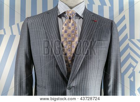 Light Gray Striped Jacket With Blue Striped Shirt And Beige Tie (horizontal)