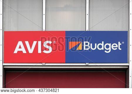 Billund, Denmark - February 20, 2019: Avis, Budget Logo On A Wall. Avis Budget Group Is The American