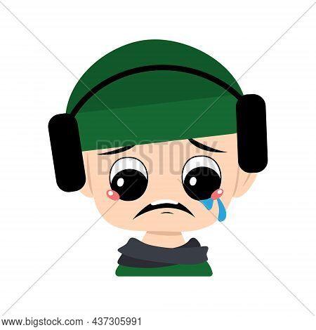Child With Crying And Tears Emotion, Sad Face, Depressive Eyes In Green Hat With Headphones. Cute Ki