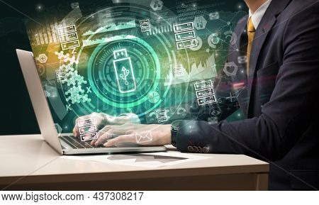 Business hand typing on a modern laptop